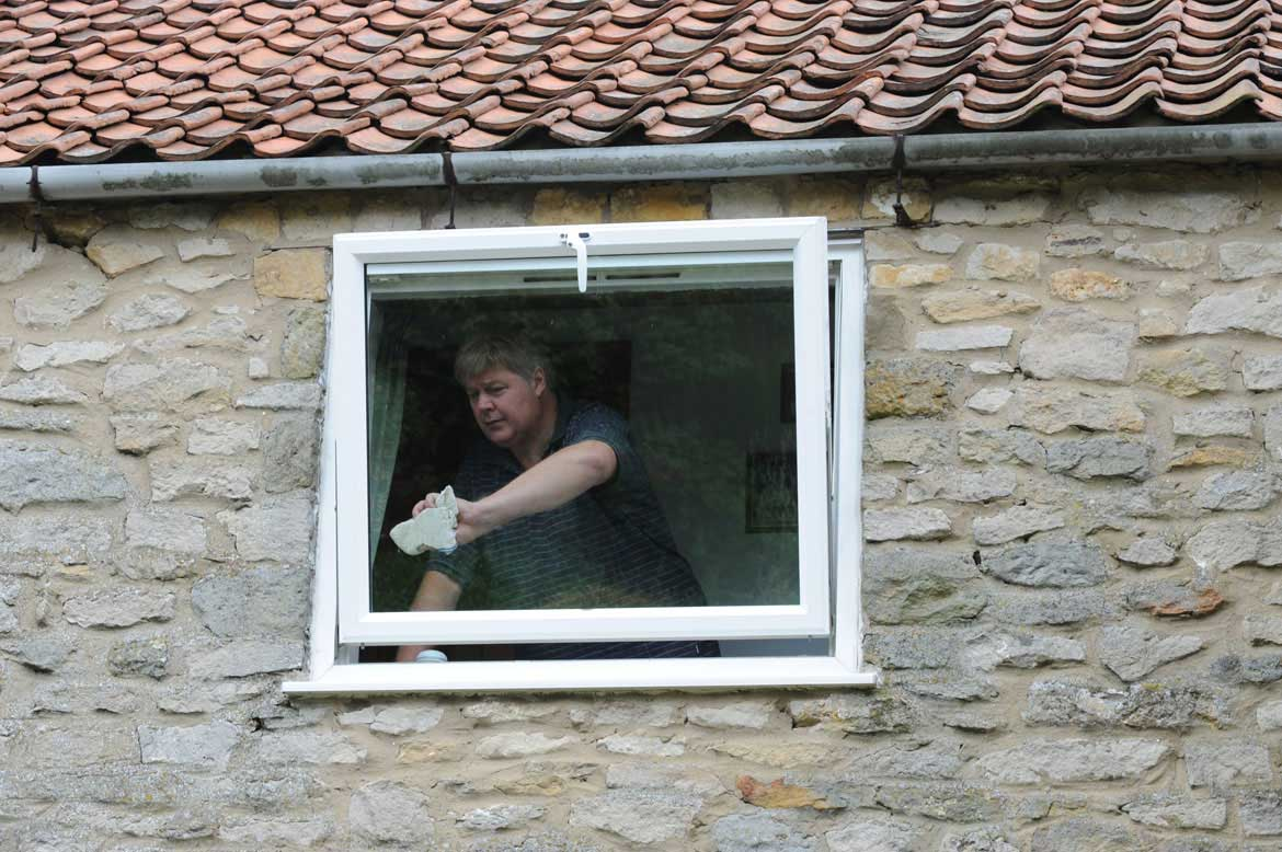 You can clean the external glass on upstairs windows from the inside of your home, safely and securely